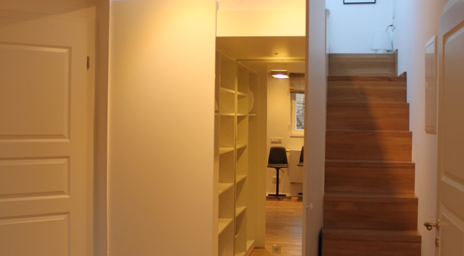 Walk-in closet under the sleeping loft